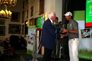 Alistair Tait receiving his award